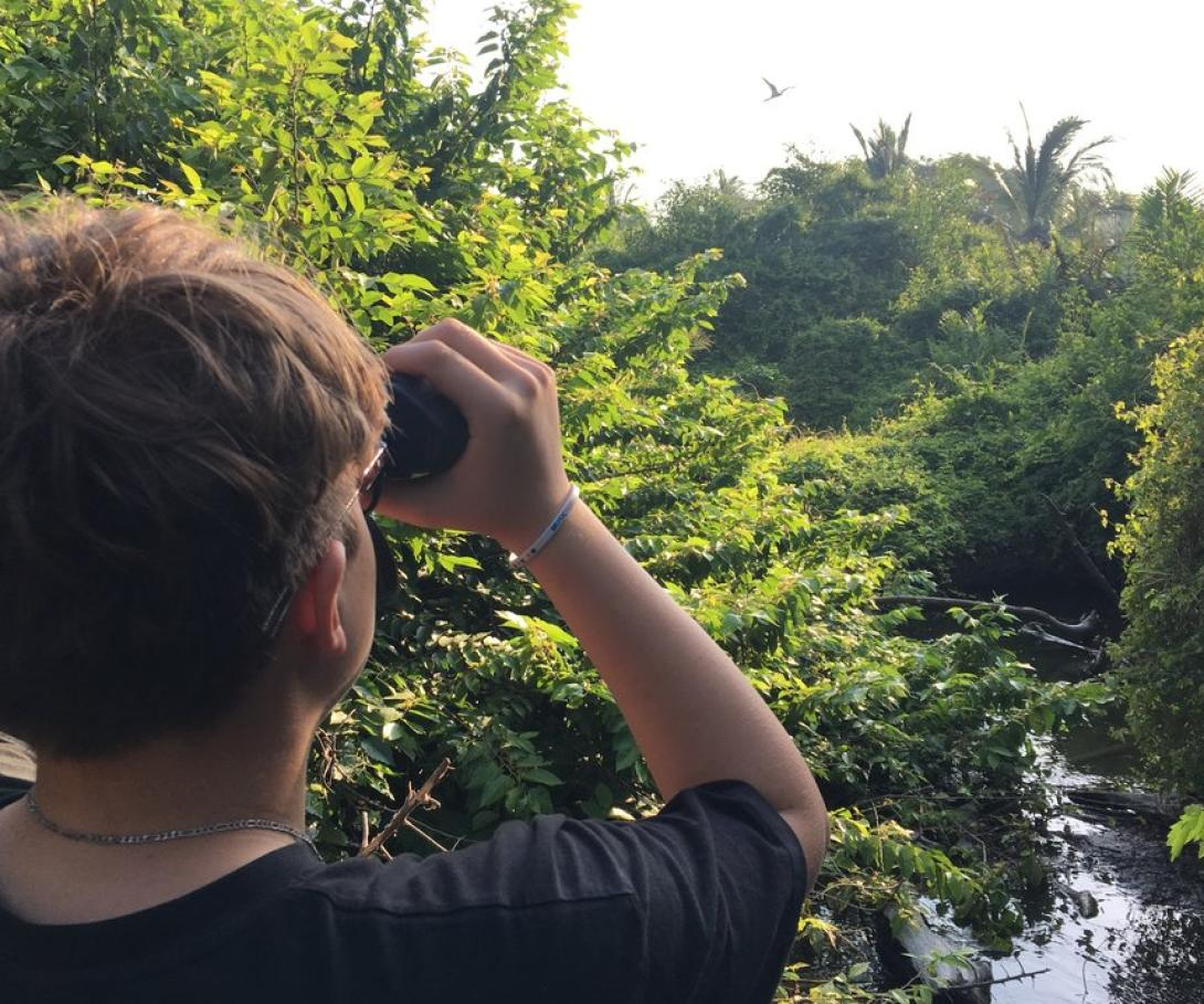 A high school student on a bespoke group trip with his peers observes birds in Mexico.